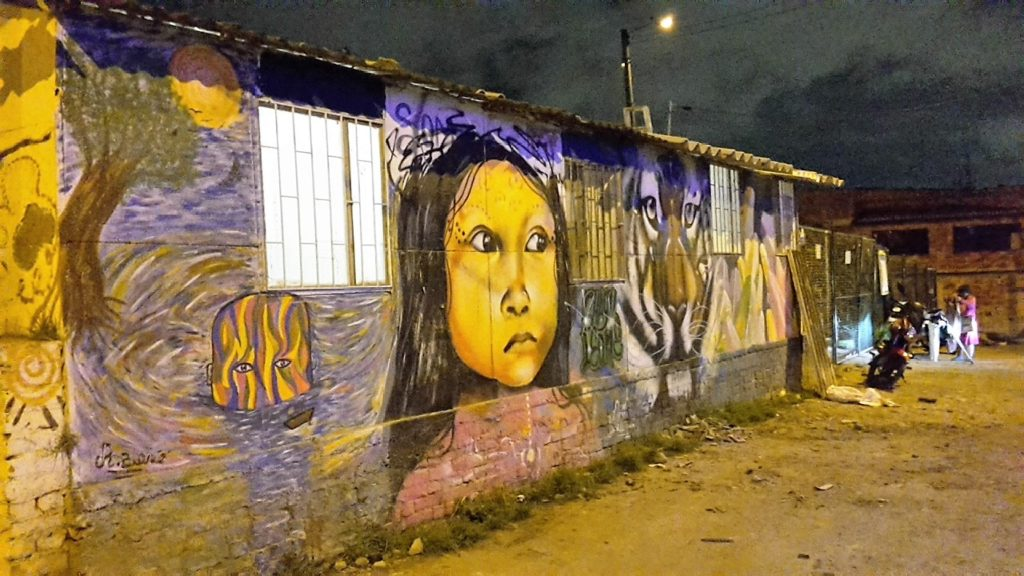 Grafiti mostrando las dos caras de Ciudad Bolivar